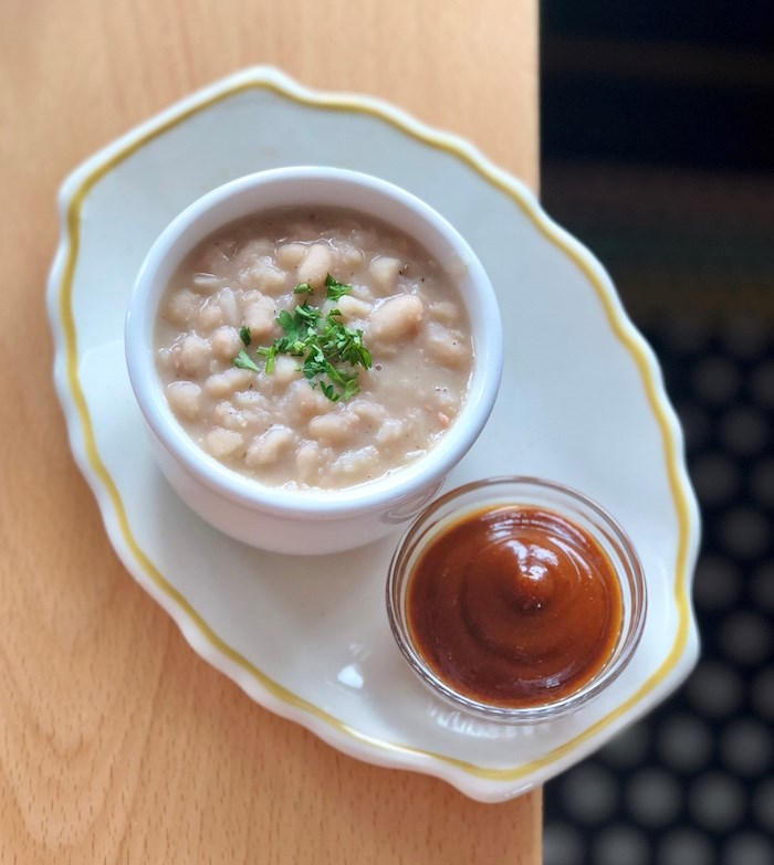 A side of French white beans with ham hock and BBQ sauce. Photo by Lindsay William-Ross/Vancouver Is Awesome
