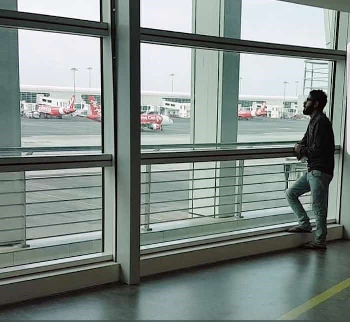 Hassan Al-Kontar looks out a window at the Kuala Lumpur International Airport, where he spent seven months waiting for a new home. - Courtesy Hassan Al-Kontar