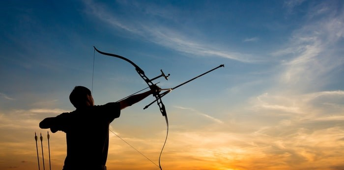 Shooting with a bow and arrow/Shutterstock