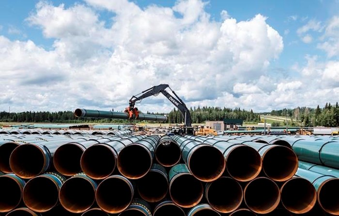 Pipe for the Trans Mountain pipeline is unloaded in Edson, Alta. on Tuesday June 18, 2019. THE CANADIAN PRESS/Jason Franson