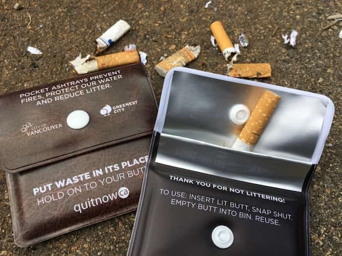 The city recently made available thousands of free pocket ashtrays for smokers to store their butts rather than snub out on the ground. Photo Dan Toulgoet