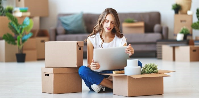 A young woman moving into her new home/Shutterstock