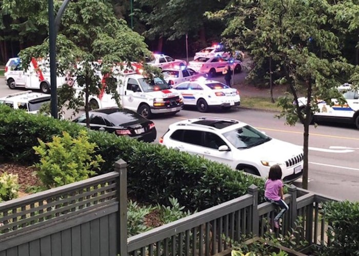 Residents reported a heavy police presence in a Lynn Valley neighbourhood Thursday evening after an intruder entered several apartments in a local condo complex. Photo supplied.