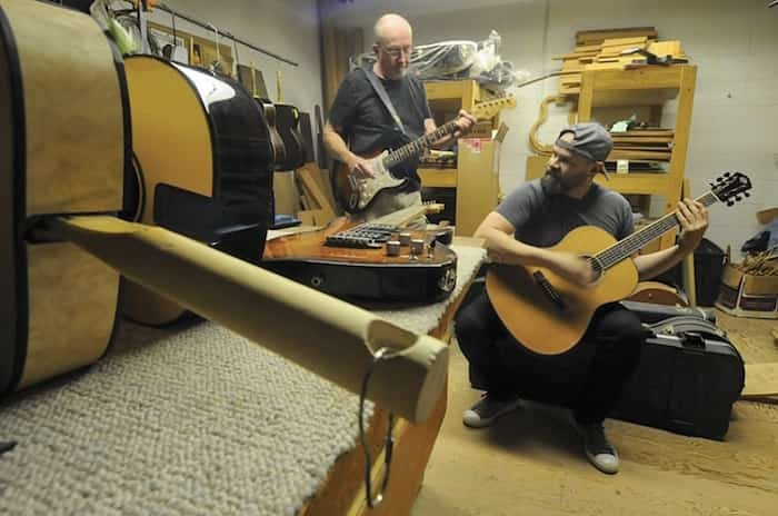 North Vancouver luthiers John Regehr and Robert Bustos both honed their craft at Larrivée Guitars. When the company moved south five years ago Bustos invited Regehr to join him in a new partnership, Vancouver Guitar Finishing. photo Mike Wakefield, North Shore News