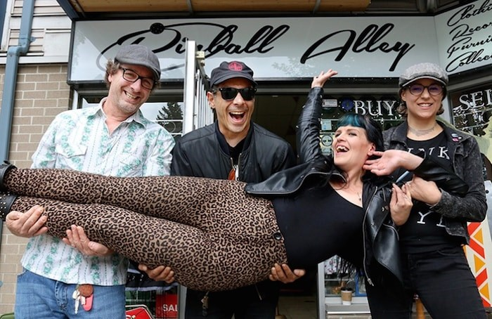 Penny Ball and her partner, Kaine Delay (centre), are about to bring their pinup and punk vibe to Port Moody's Pinball Alley Vintage shop as owners Johnny Barnes and Heather Wallace prepare to up stakes for Spain. Photo by Mario Bartel/Tri-City News