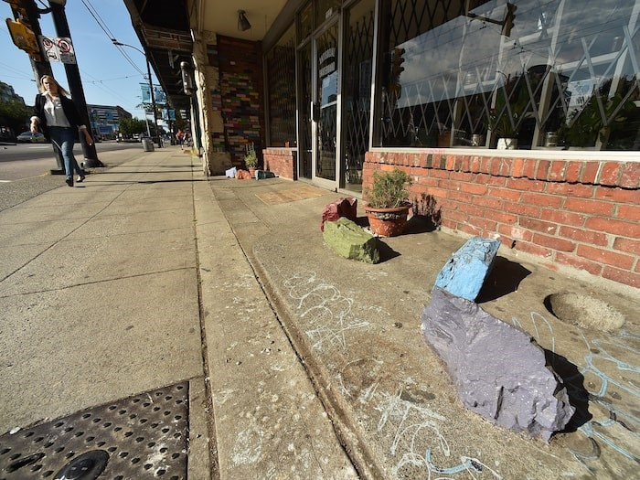 An employee of Antisocial says the rocks outside the shop were there long before the Main Street skateboard store opened. Photo by Dan Toulgoet/Vancouver Courier