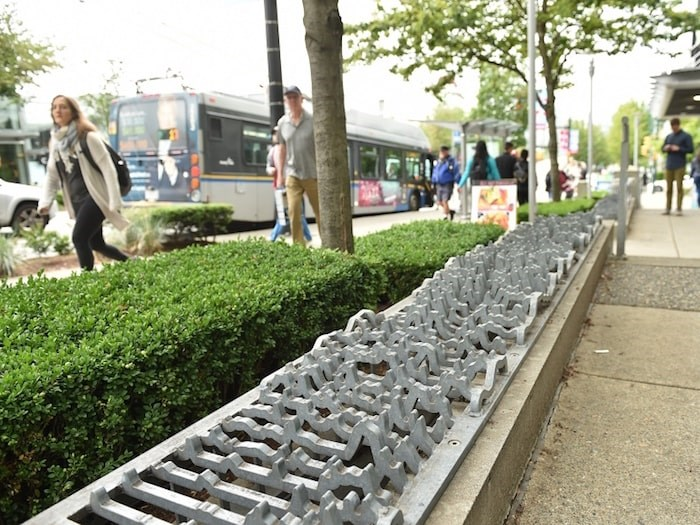 The City of Vancouver says these wavy, metal vent covers on Cambie are an art installation and weren't intended to prevent people from sleeping there. Photo by Dan Toulgoet/Vancouver Courier