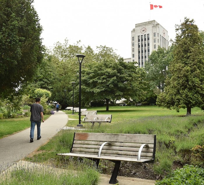 Benches, such as these found at city hall, are divided by an arm rest that prevents people from sleeping on them. Photo by Dan Toulgoet/Vancouver Courier