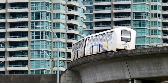 Photo: SkyTrain cars turn a corner at Gilmore station in Burnaby.