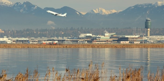 A flight takes off from YVR Airport near Vancouver/Shutterstock