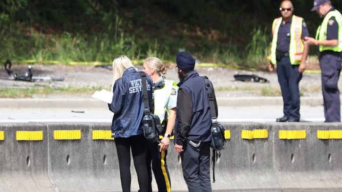 Police investigators on scene after a cyclist was struck by a driver Saturday afternoon on Gaglardi Way. The cyclist has since died. Photo by Shane MacKichan