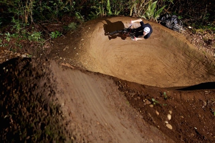 BMX bikers have built an extensive network of berms and jumps in a conservation area in North Burnaby.