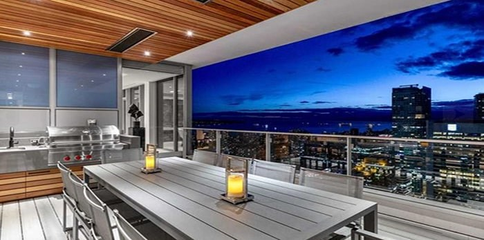 The largest of five terraces has an outdoor kitchen and dining area, with sunset ocean views. Listing agents: Malcolm Hasman, Jason Soprovich