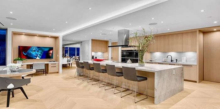 The lavish kitchen has a casual eating area that is distinct from the formal dining area. Listing agents: Malcolm Hasman, Jason Soprovich