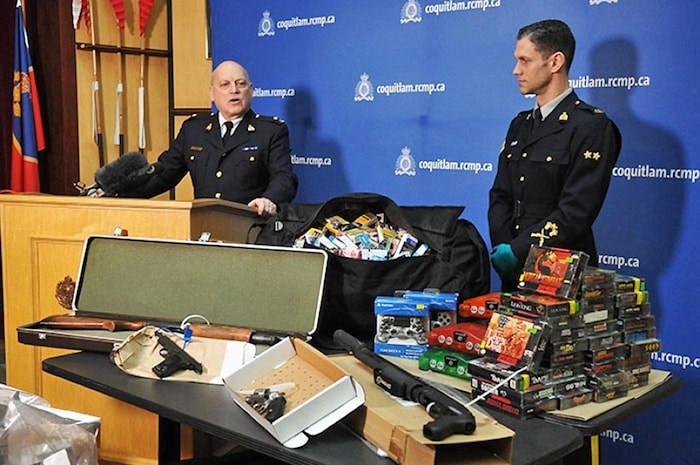 Coquitlam RCMP Insp. Bryon Massie (left) and Cpl. Michael McLaughlin show some of the stolen items seized from a Coquitlam storage locker after Dillon Stanton and Nicholas Traviss were arrested. Photo via Burnaby NOW
