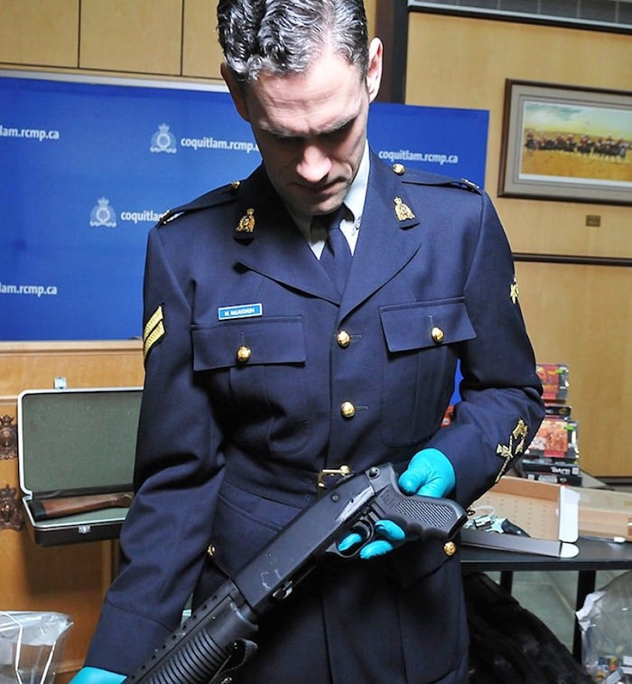 Coquitlam RCMP Cpl. Michael McLaughlin shows the filed-off serial number on a stolen gun. Photo via Burnaby NOW