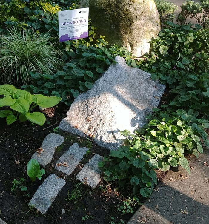 The granite markers at the intersection of West 11th and Maple Street symbolize a gateway to the Arbutus Greenway. Photo: Réjean Beaulieu