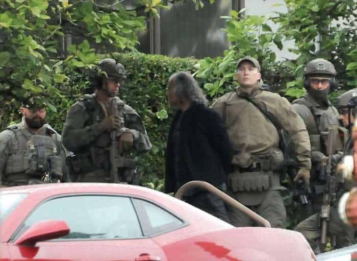 A man is taken into custody by heavily armed police offers following a standoff on the steps of the North Vancouver courthouse Wednesday, July 10. Photo: Mike Wakefield / North Shore News