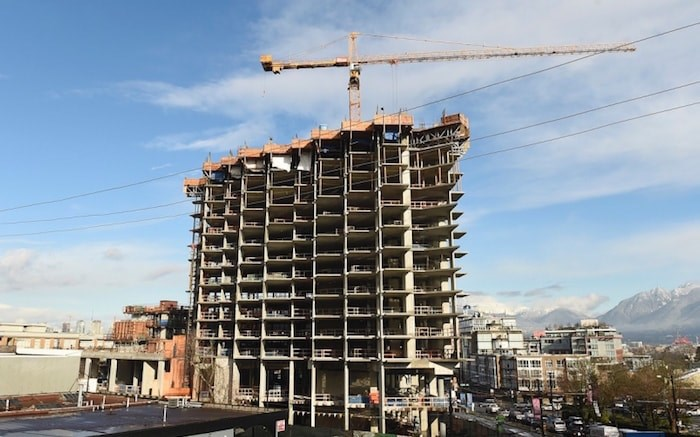 Over the past four years, photographer Dan Touloget has visited the construction site of the Independent more than 50 times to document the progress of the controversial 21-storey building and its growing presence in Mount Pleasant. Photo by Dan Toulgoet/Vancouver Courier
