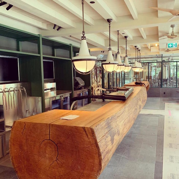 A log bar installed inside the brewpub space.