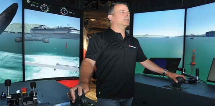 Master Tony Poole takes the helm inside Seaspan's brand new tug simulator training tool. Photo: Paul McGrath, North Shore News