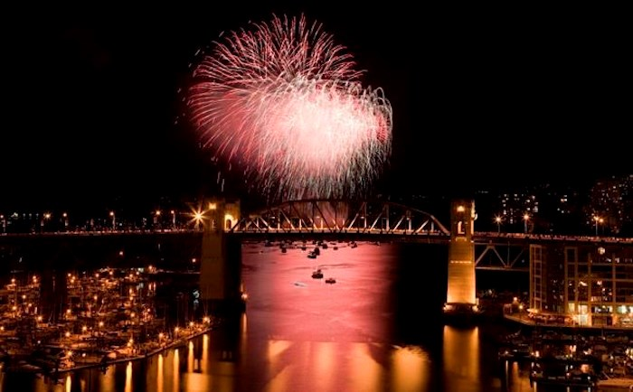 The Burrard Street Bridge is seen in the foreground as fireworks from team China blast over the waters of English Bay during the 21st annual Celebration of Light in Vancouver, Saturday, July 30, 2011. Vancouver's 29th annual fireworks extravaganza is set to showcase the pyrotechnical skills of India, Croatia and Canada as the three countries light up the sky this summer. THE CANADIAN PRESS/Jonathan Hayward