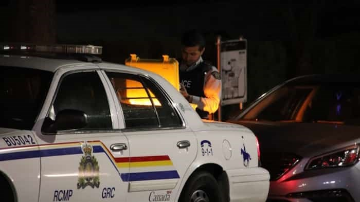 Burnaby RCMP were on the scene at an apparent carjacking that sent an 18-year-old male to hospital with stab wounds just after midnight Monday. Photo: Shane Mackichan