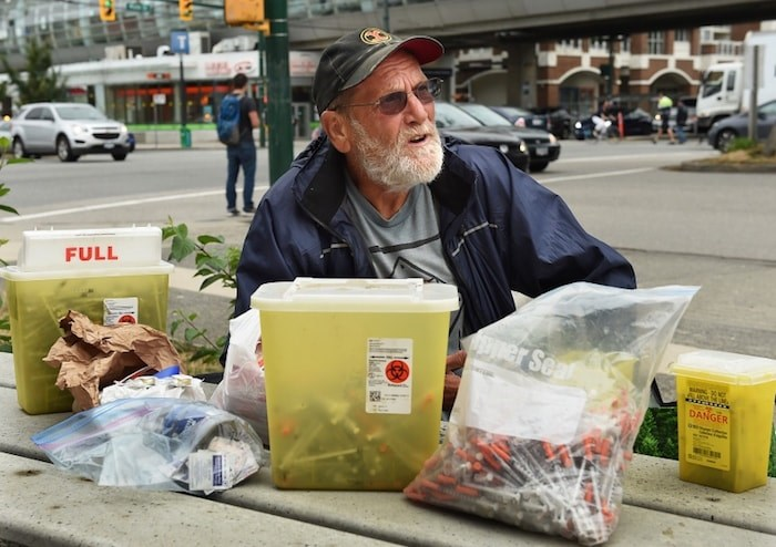 Charles Bafford, who lives in a modular housing building at Main and Terminal, spends his days picking up discarded needles in Vancouver. Photo by Dan Toulgoet/Vancouver Courier