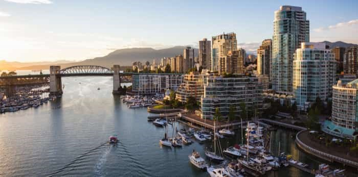 View of Downtown Vancouver and Burrard Bridge at False Creek during sunny sunset/Shutterstock