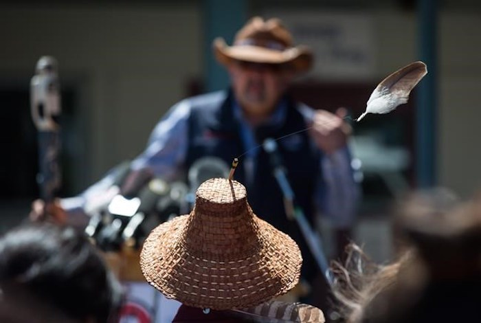 An eagle feather attached to a hat worn by Kwikwetlem First Nation Chief Ed Hall blows in the wind as Chief Joe Alphonse, back, Tribal Chair of the Tsilhqot'in National Government, speaks during a ceremony to commemorate the wrongful trial and hanging of Chief Ahan, in New Westminster, B.C., on Thursday July 18, 2019. Chief Ahan, who was hanged in the city on July 18, 1865, was one of six Tsilhqot'in First Nation chiefs who were executed following the Chilcotin War between the Tsilhqot'in people and European settlers. THE CANADIAN PRESS/Darryl Dyck
