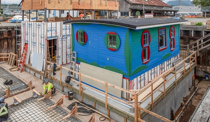 The Blue Cabin in dry dock with sustainable deckhouse under construction next to it.