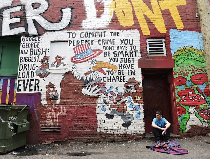 Messages mix with paint in this notorious Downtown Eastside alley. Photo by Dan Toulgoet/Vancouver Courier