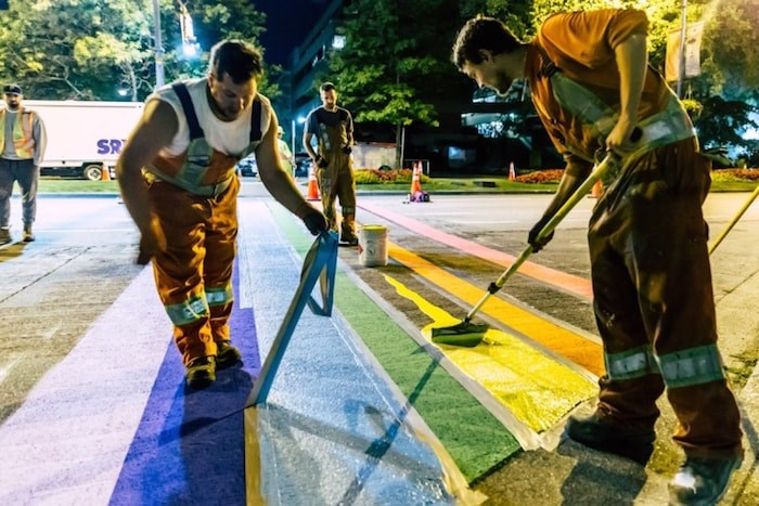 Workers painting the last couple stripes of the rainbow crosswalk at 12:30 a.m. on Sunday. Photo courtesy Herb Chao