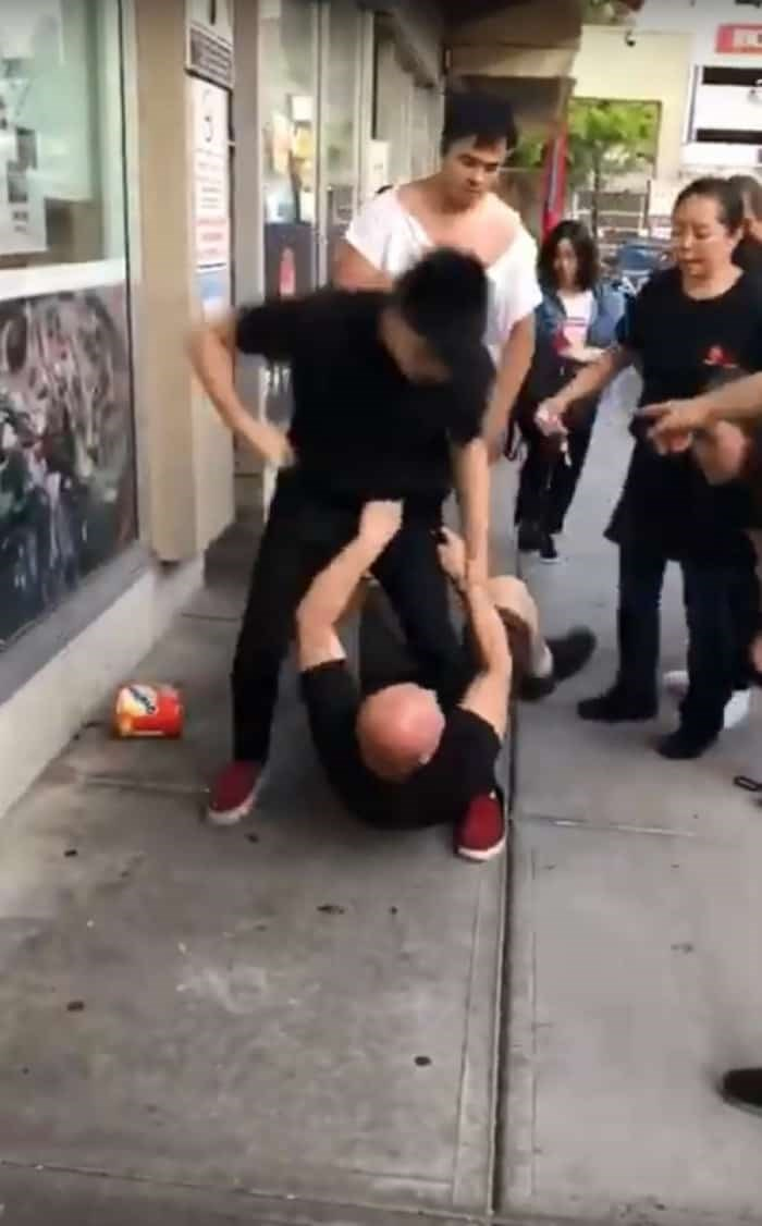 The restaurant owner was pushed on the ground, and the customer was trying to hit him in the head. /