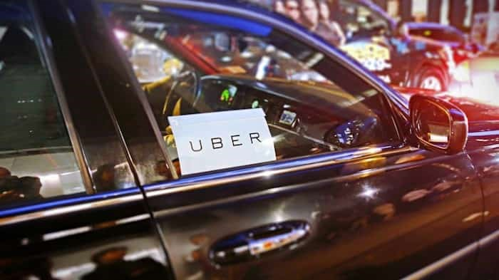 The City of Burnaby plans to put ride-hailing services on a level playing field with taxis by requiring a business licence to operate in the city. Photo: Uber / Shutterstock