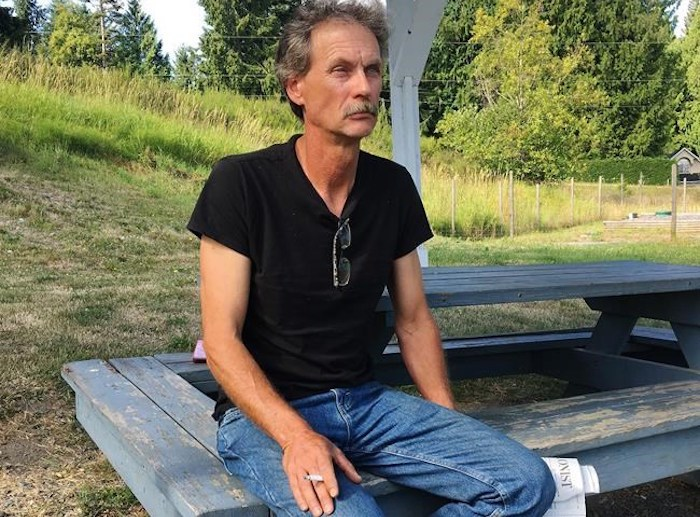 Alan Schmegelsky, father of Bryer Schmegelsky, poses for a photo during an interview with The Canadian Press in Mill Bay B.C. on Wednesday, July 24, 2019. The father of a suspect in the deaths of three people in northern British Columbia says his son is in