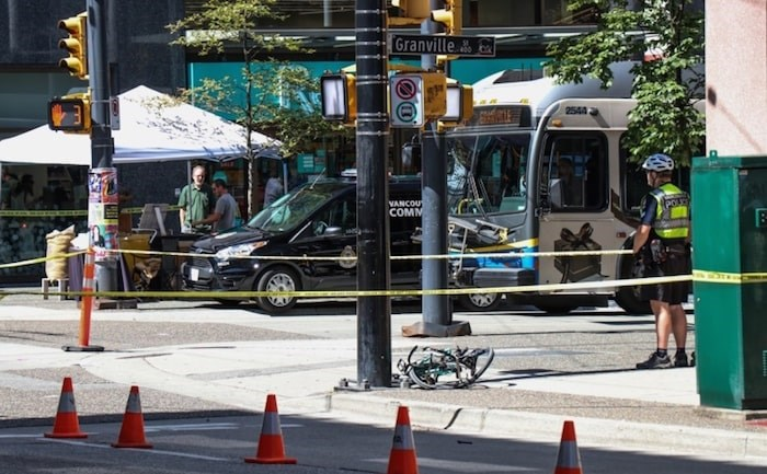 Vancouver police collision investigators had a corner of Pender and Granville streets cordoned off after a cyclist was hit by a vehicle. Photo Bradley Fehr