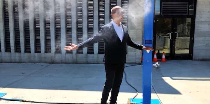 Photo: Coun. Pete Fry takes one of the city's new misting stations for a spin at a media briefing July 25. Photo Bob Kronbauer / Vancouver Is Awesome