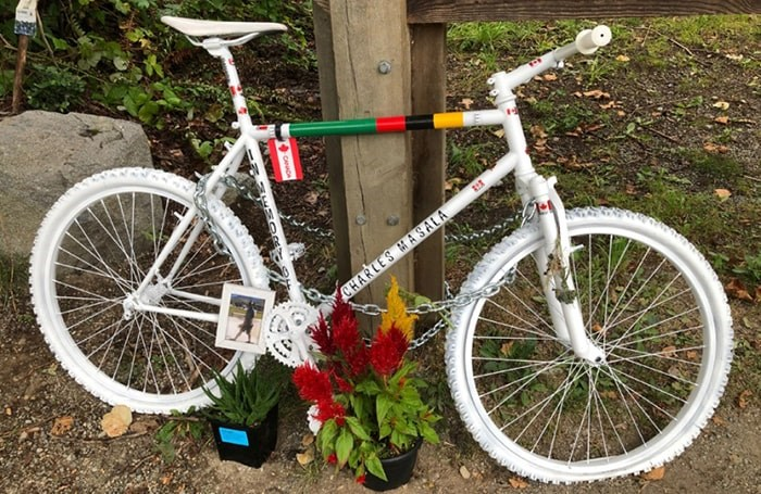 This tribute to Charles Masala has been chained to a post on Gaglardi Way in Burnaby. Photo: Chris Campbell