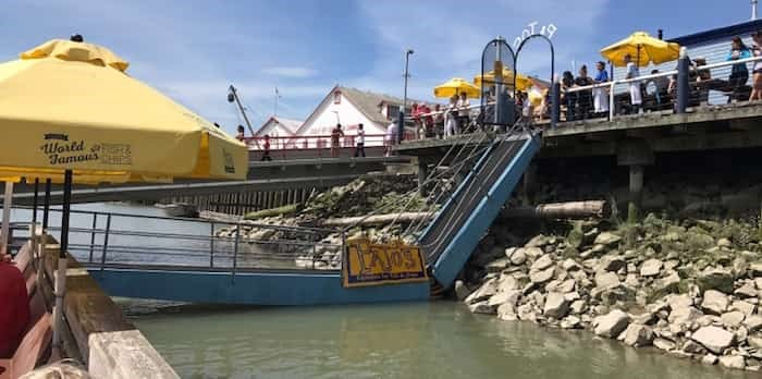 This photo of the collapsed walkway at Pajo's in July 2017 was taken by one of the people stranded on the floating dock. Photo: Twitter
