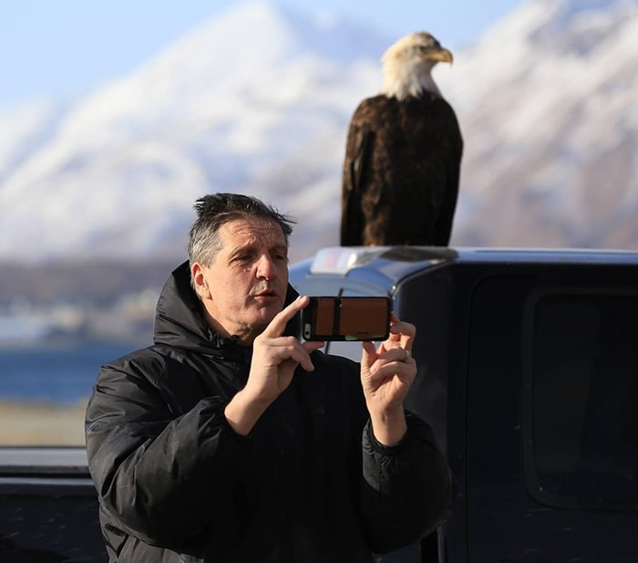 Christian Sasse stops to take a selfie with an eagle while out on a photo shoot. Photo: Sasse Photo Facebook