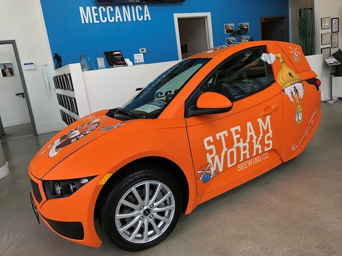 Steamworks' Burnaby brewery is going green with their new, orange electric car, the single-passenger Solo by Vancouver-based Electra Meccanica. Photo courtesy Steamworks