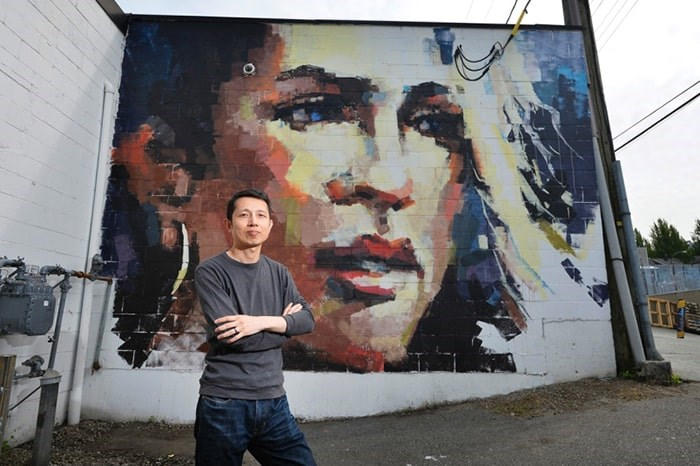 William Liao stands with his completed work for Vancouver Mural Festival. This year's festival starts Thursday and will feature 25 new murals. Photo Jennifer Gauthier