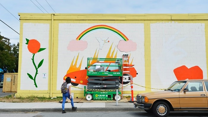 Alex Joukov works on her mural for Vancouver Mural Festival on East Fifth Avenue. This year's festival starts Thursday and will feature 25 new murals. photo Jennifer Gauthier