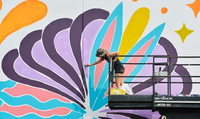 Olivia di Liberto works on her mural for Vancouver Mural Festival. This year's festival starts Thursday and will feature 25 new murals. photo Jennifer Gauthier