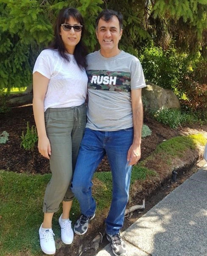 An Iranian-born Canadian resident has returned to British Columbia after being imprisoned and allegedly tourtured in his home country for 11 years. Saeed Malekpour, left, poses for a photo with his sister Maryam Malekpour in a Saturday, Aug. 3, 2019, handout photo. THE CANADIAN PRESS/HO-Kimberley Motley