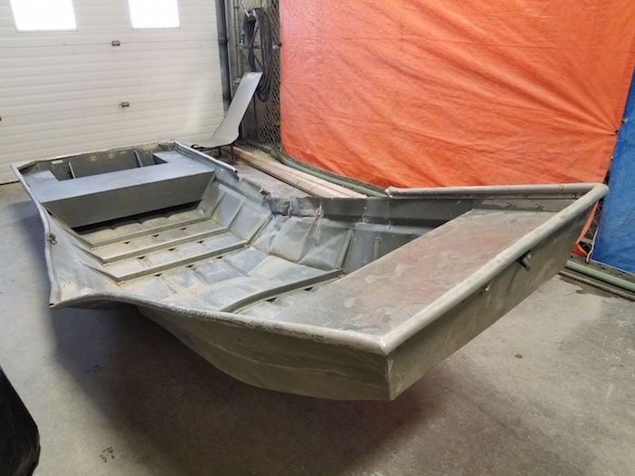 A damaged aluminum boat found in Manitoba has prompted the launch of an underwater search for B.C. fugitives. Photo courtesy Manitoba RCMP