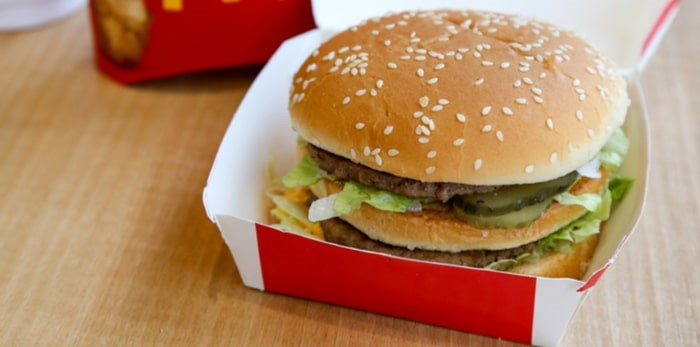 Two all-beef patties, special sauce, lettuce, cheese, pickles, onions, on a sesame seed bun. URAIWONS/Shutterstock.com
