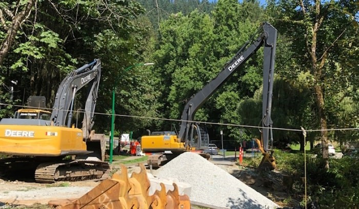 Machines work to clear material for the Ash Grove culvert project in North Burnaby. An area resident says too many trees were cut down, and without sufficient warning. Photo by Chris Campbell/Burnaby NOW