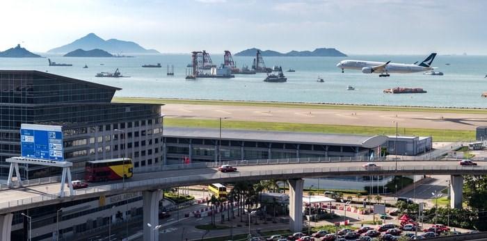 A plane lands at Hong Kong International Airport. EarnestTse/Shutterstock.com